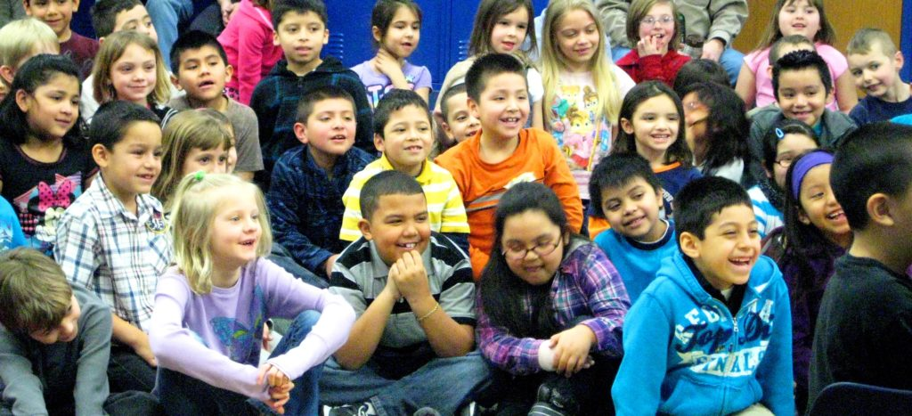Children laugh as Holly Nagel shares something silly!
