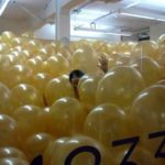 Assisting a team with inflation...2,887 balloons!